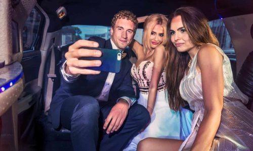 prom transportation - friends in the back of limo